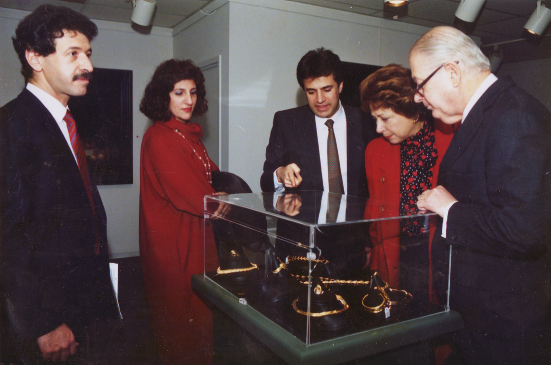 Jewelry designer George Maramenos giving HE the Ambassador of Greece and Mrs. George Papoulias the grand tour of his designs at Zygos Gallery.